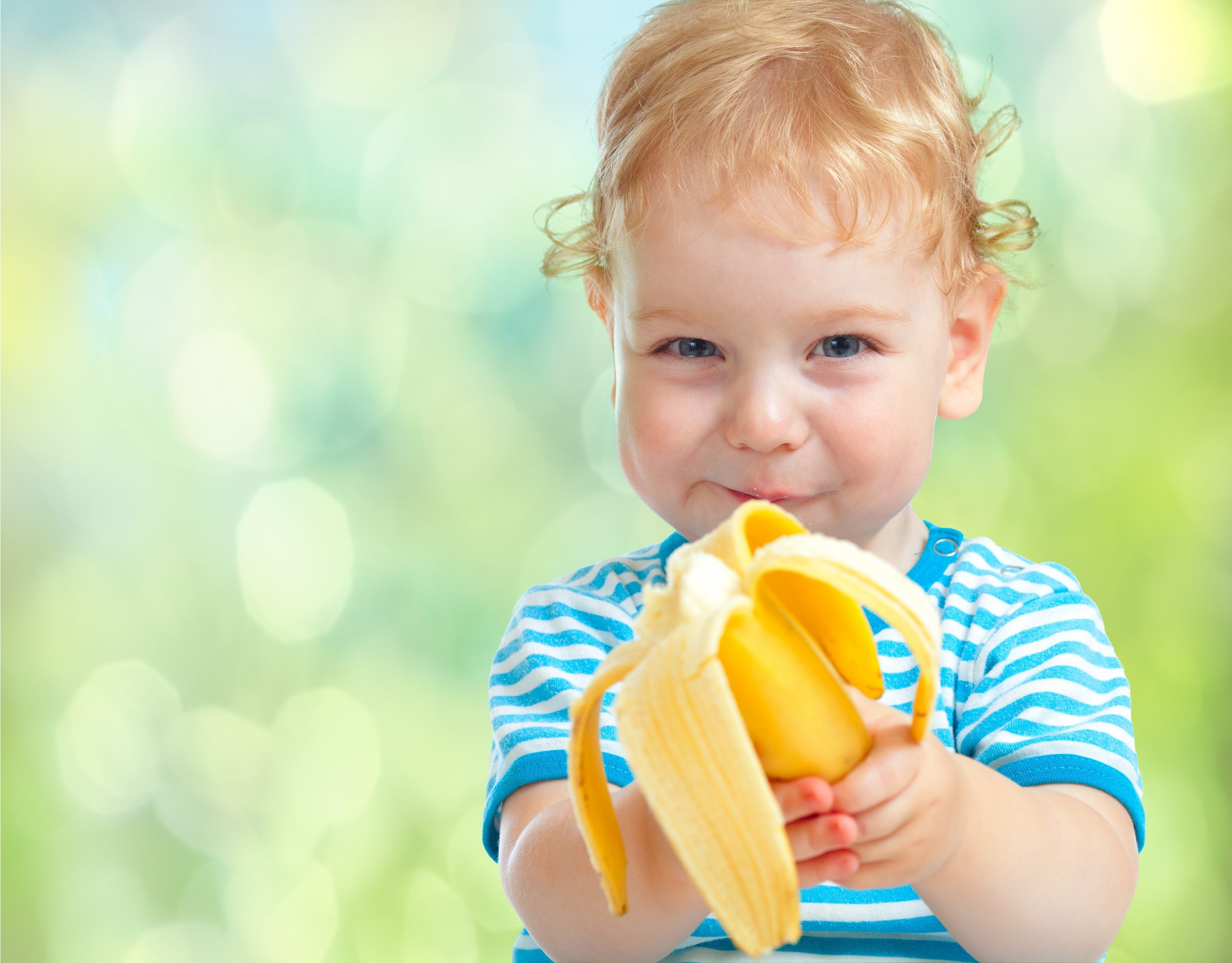 child with banana