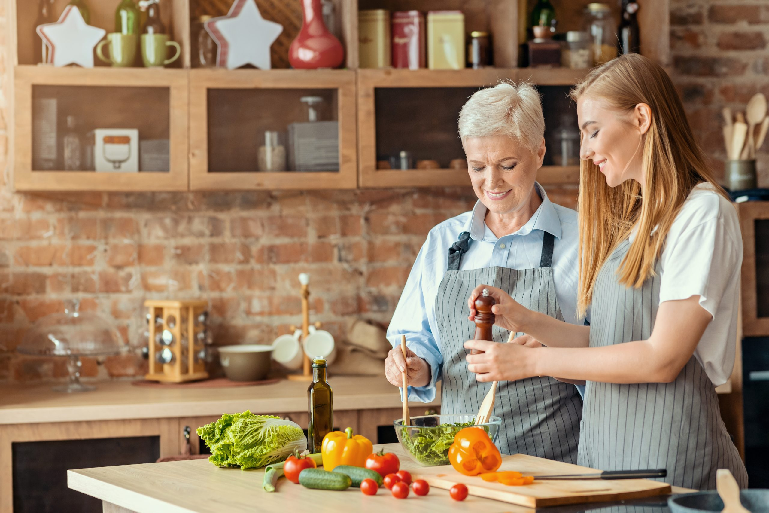 vitamins and minerals, healthy diet, Beautiful happy mother and daughter cooking healthy food, Beautiful happy mother and daughter cooking healthy food